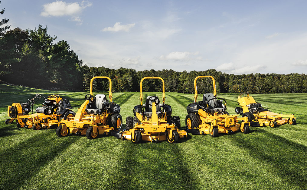 Commercial lawn mowers on striped lawn