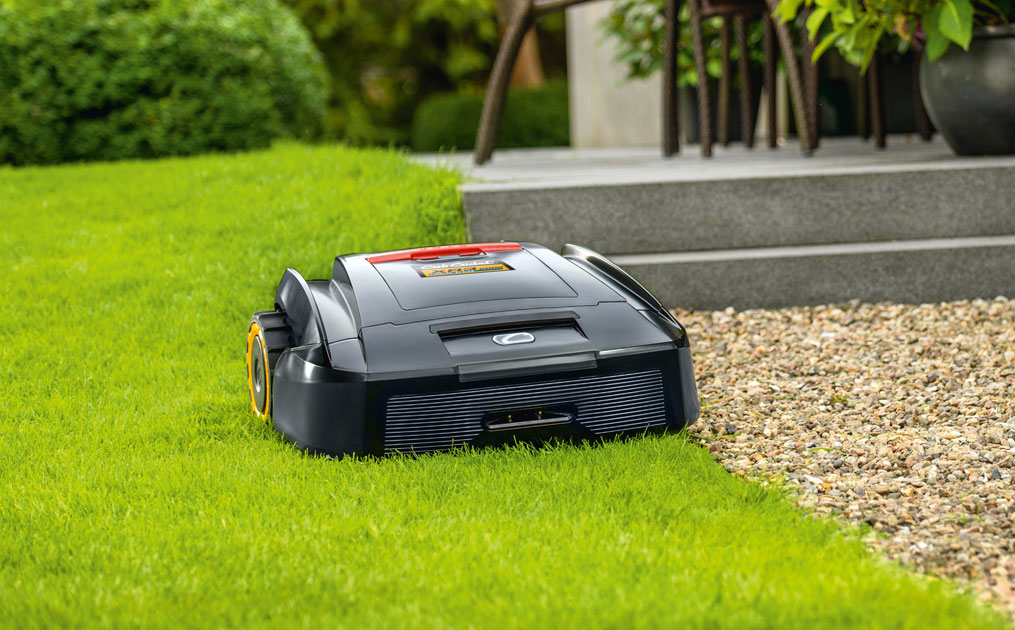 Autonomous mower cutting grass in a flat yard