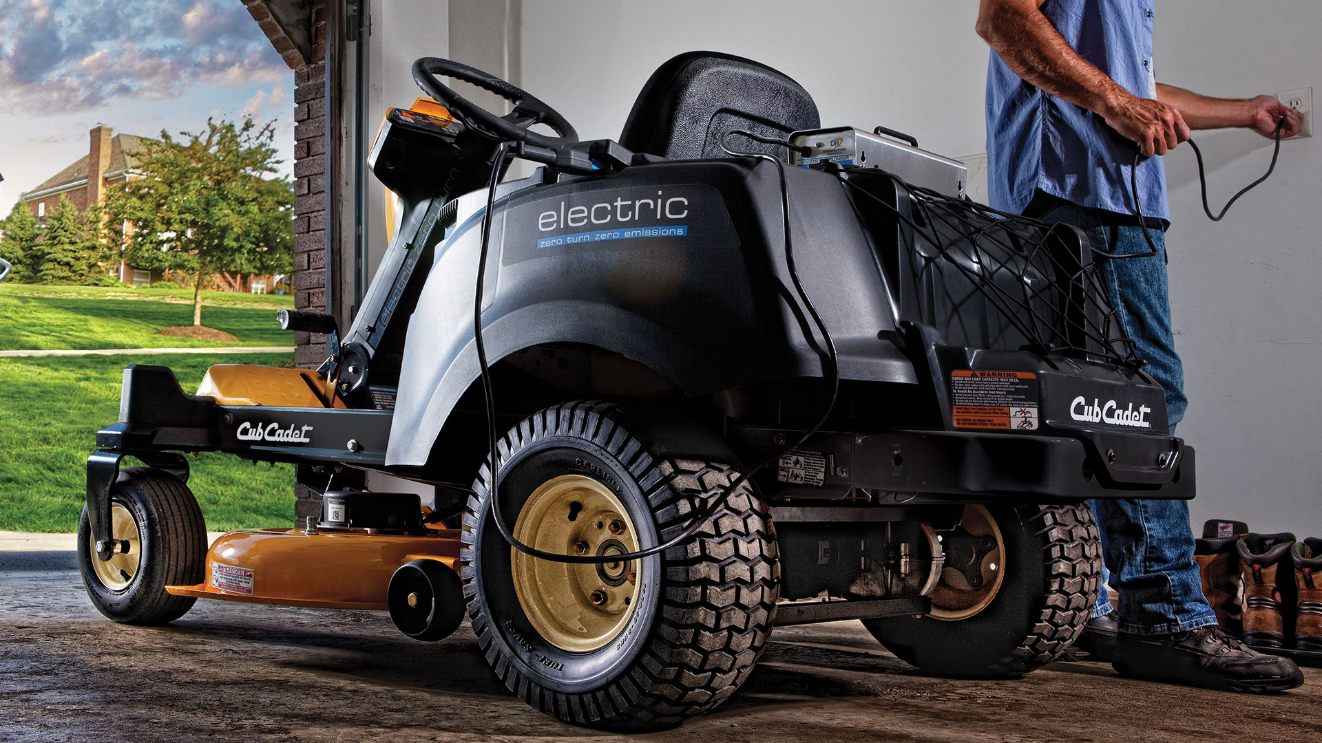 electric riding mower in garage