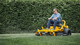 zero-turn mower cutting grass