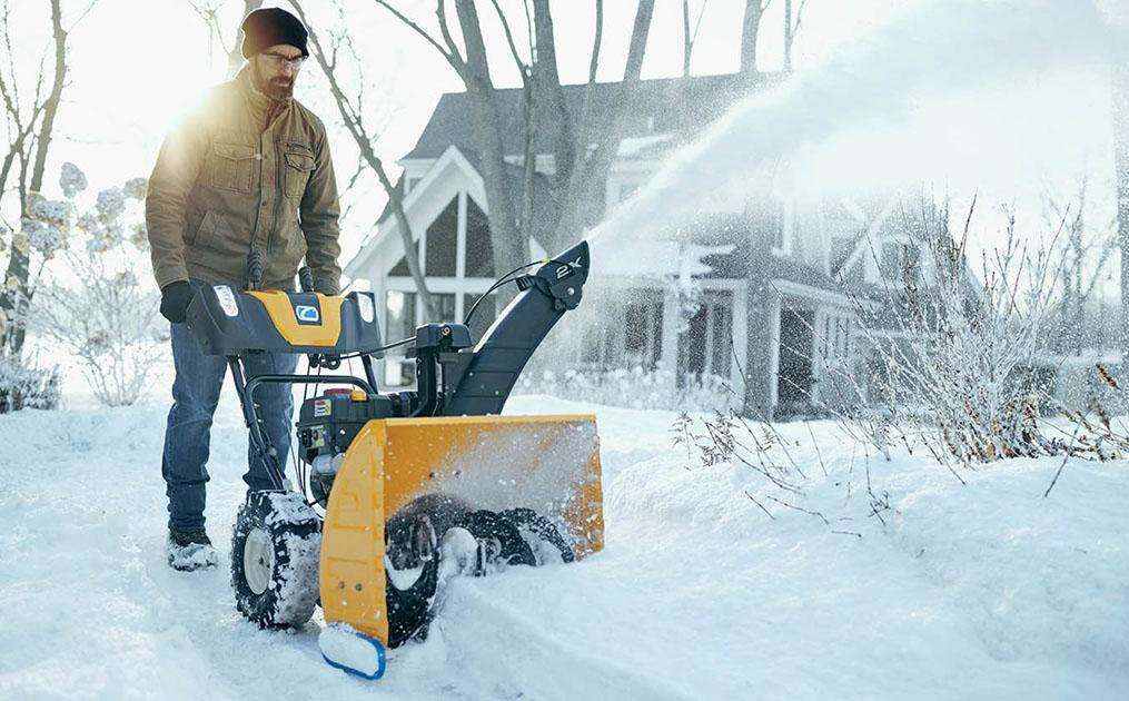 man-blowing-snow