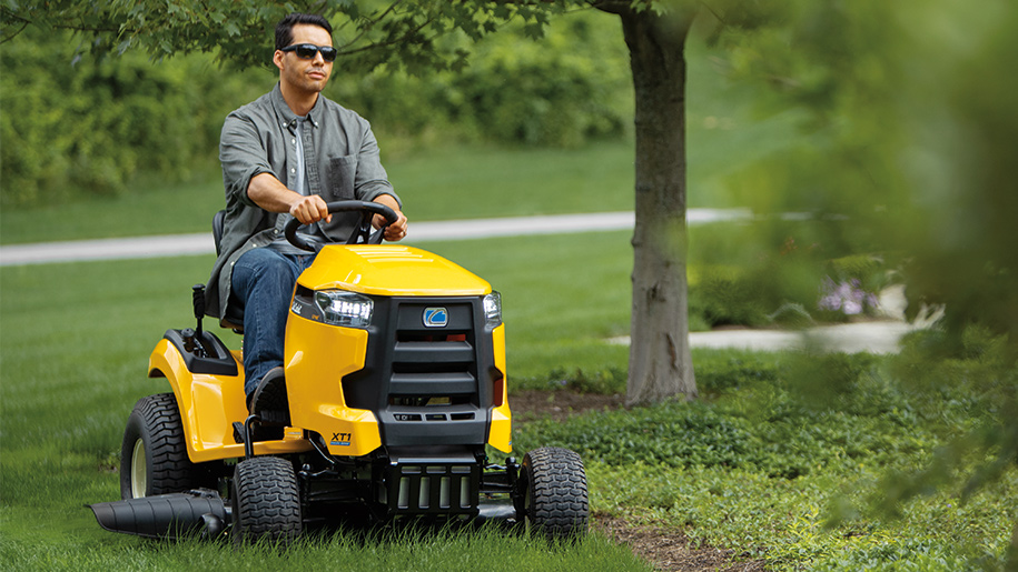 Video: man riding mower