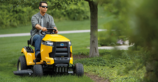 Photo: IntelliPower-man driving riding mower