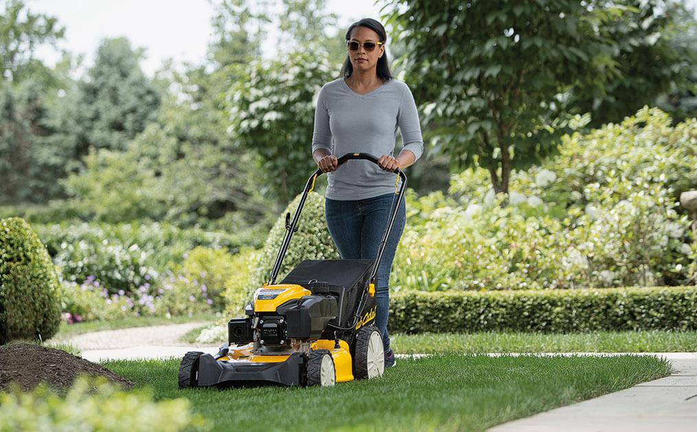 woman-pushing-mower