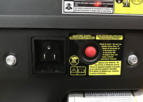 close up of a push button electric start on cub cadet snow blower
