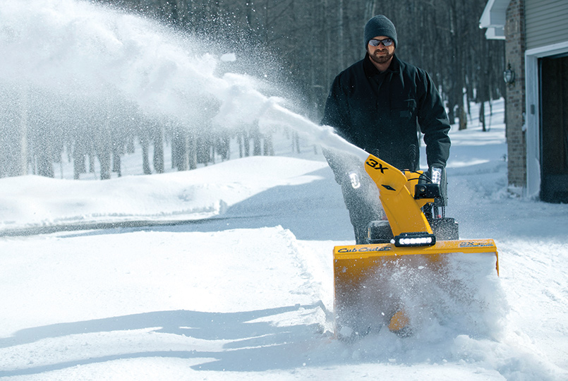 three stage snow blower discharging snow to the right