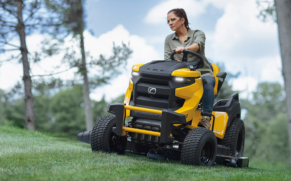 woman cutting lawn with new xt2 riding mower