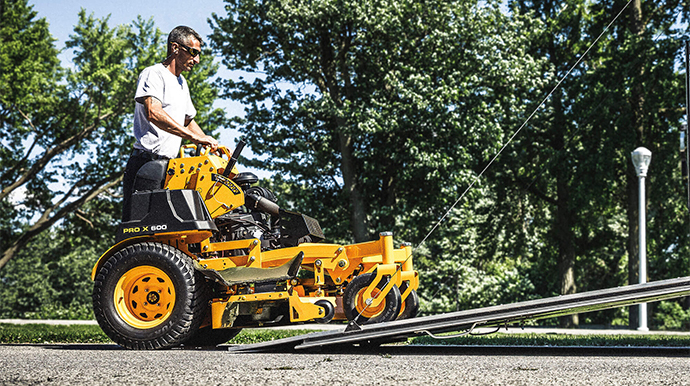 man using commerical stand on mower