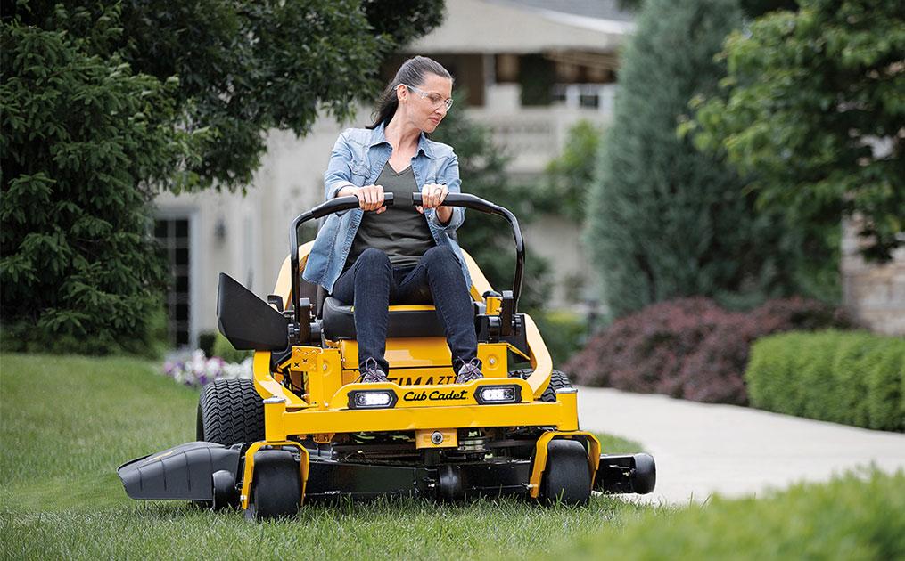 woman riding zero turn mower