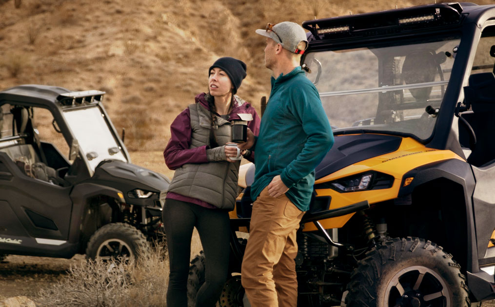 Man and Woman standing in front of a Cub Cadet UTV_Challenger holding coffee